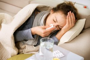 woman lying in bed sick medication