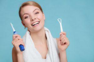 Woman with tongue scraper