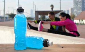 people working out with sports drinks