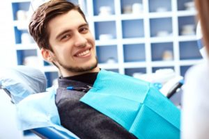 man experiencing benefits of tooth extraction